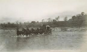 Stagecoach fording a river